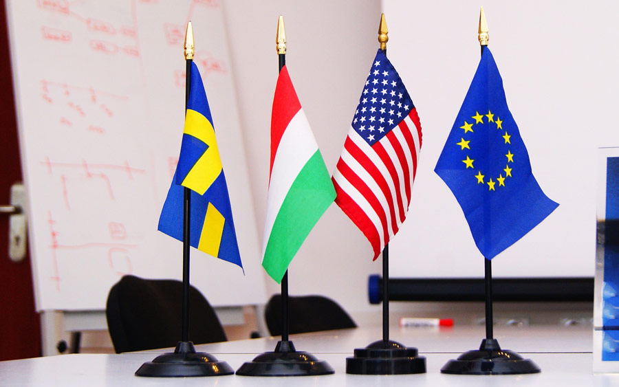 mini flags on flag poles on a desk