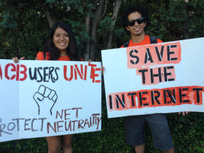 Two protesters for net neutrality